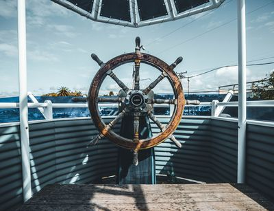 A ship's wheel in the bow.
