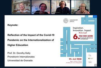 """Screenshot eines Video-Chats, bei dem zwei Frauen und zwei Männer in die Kamera schauen. Den größten Teil des Bildes macht eine PowerPoint-Folie mit dem Titel der Rede """"Reflection of the impact of the Covid-19 pandemic on the internationalization of higher education"""" aus."""