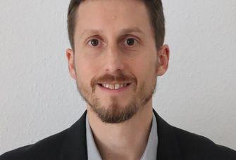 Dr. Christian Simon